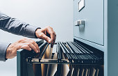 Office clerk searching for files
