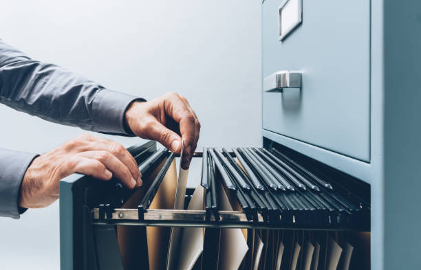 Office clerk searching for files stock photo