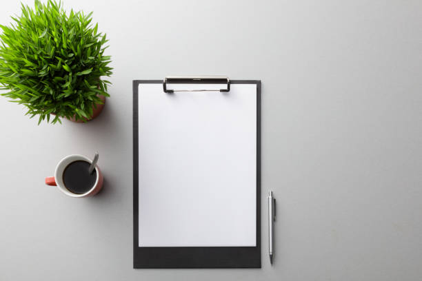 Office: Clipboard, Coffee and Plant Still Life stock photo