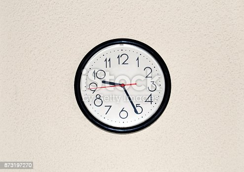 Office clock placed in the wall.