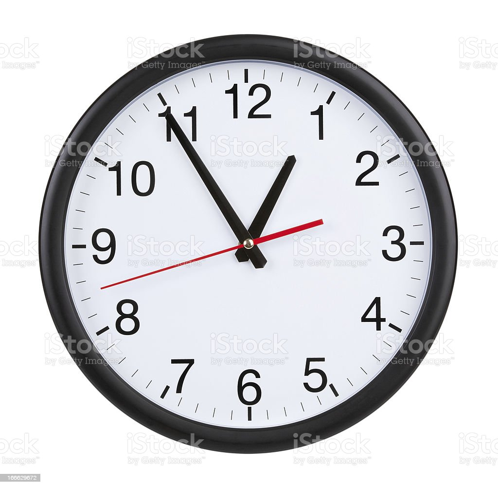 Office clock shows five minutes to an hour royalty-free stock photo