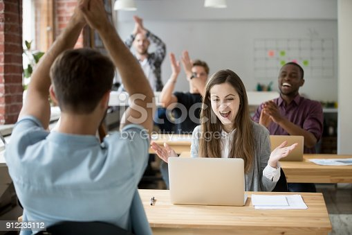 istock Office colleagues congratulating happy woman excited by good news online 912235112