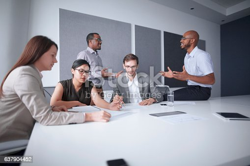 istock Office colleagues conversing in business meeting 637904452