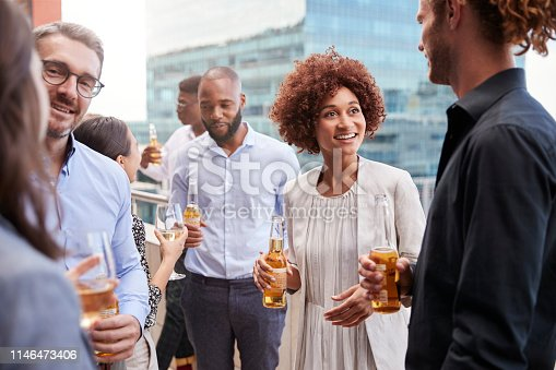 Office colleagues socialising with drinks in the city after work