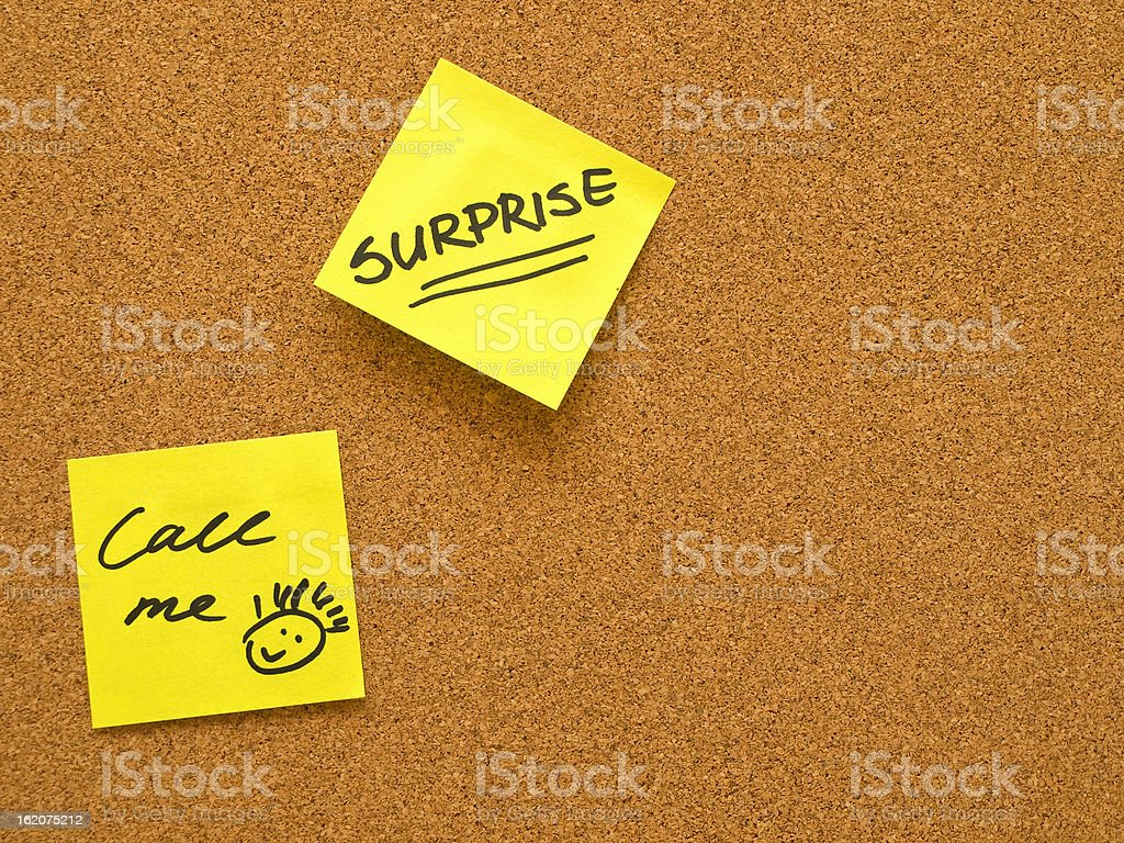 office cork board with yellow post it notes royalty-free stock photo