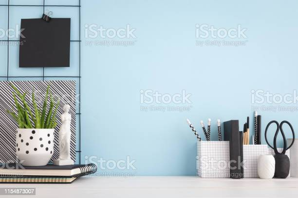 Office creative desk with supplies and blue wall mock up picture id1154873007?b=1&k=6&m=1154873007&s=612x612&h=mozgqp4d3aeqatdcb cuombl9rno8p8sjvqbrvhcmgq=