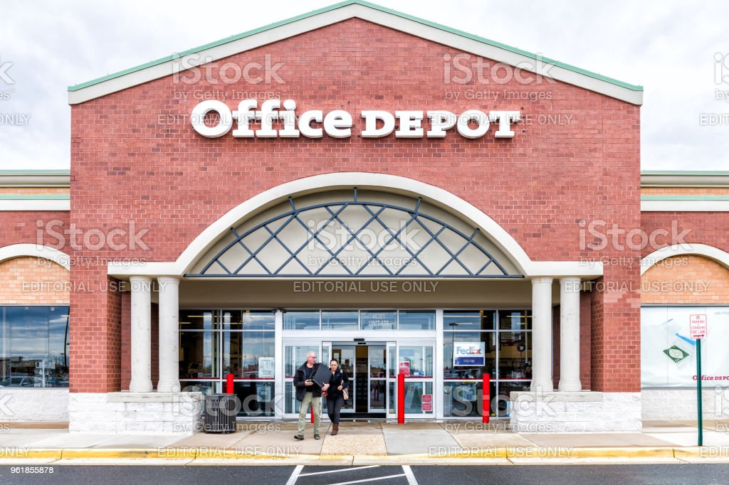 Office Depot store in Fairfax county, Virginia shop exterior entrance with sign, logo, doors , couple walking out stock photo