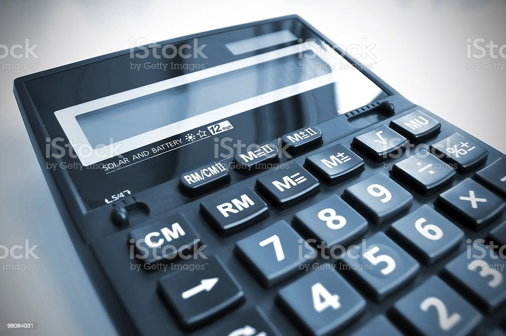 Office desk calculator with reflection of daylight. XL size. royalty-free stock photo