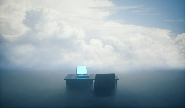 Office desk in the sea of fog stock photo