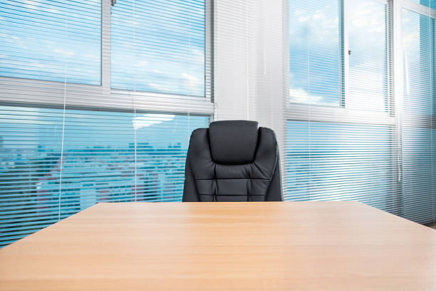 Office desk Office desk and chair in a modern office building. empty desk stock pictures, royalty-free photos & images