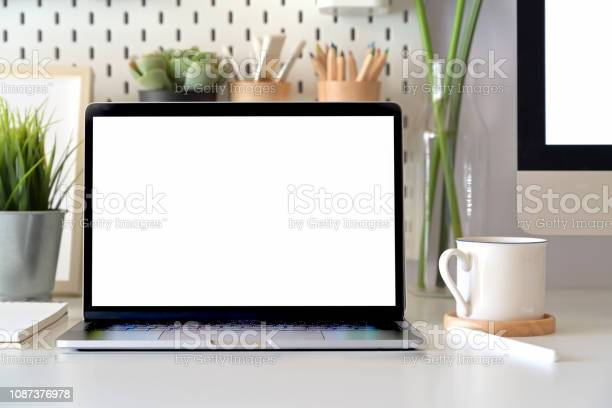 Office desk scenery with mockup blank screen laptop computer minimal picture id1087376978?b=1&k=6&m=1087376978&s=612x612&h=aeqsfmlzqkafhdrvcodujfccwinqaryixhbill9rsrc=