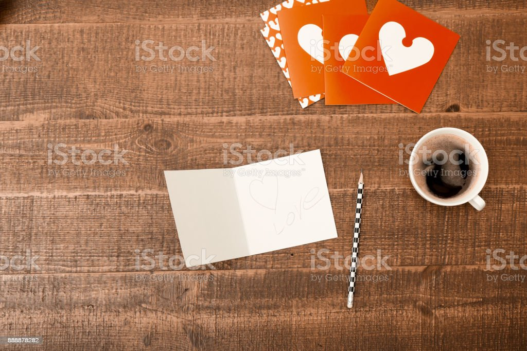 Office Desk Table Top View With Blank Greeting Card Pencil And