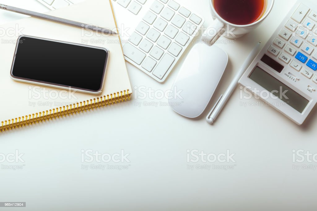 Office desk table with computer keyboard, supplies, calculator, pen, glasses zbiór zdjęć royalty-free