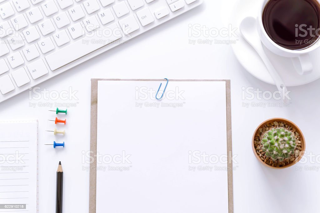 Office desk table with computer, supplies and coffee cup. stock photo
