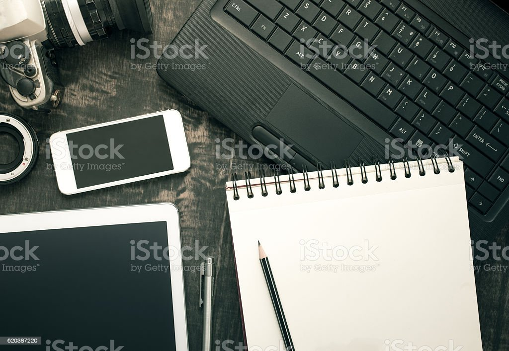 Office desk table with computer, supplies and tablet, mobile pho stock photo