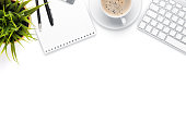 istock Office desk table with computer, supplies, coffee cup and flower 499650166