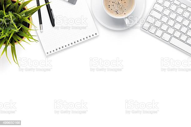 Office desk table with computer supplies coffee cup and flower picture id499650166?b=1&k=6&m=499650166&s=612x612&h=b5kn8yrn cd7wlpe pc9p3zoxkpkvcjjursrjvw0wx4=