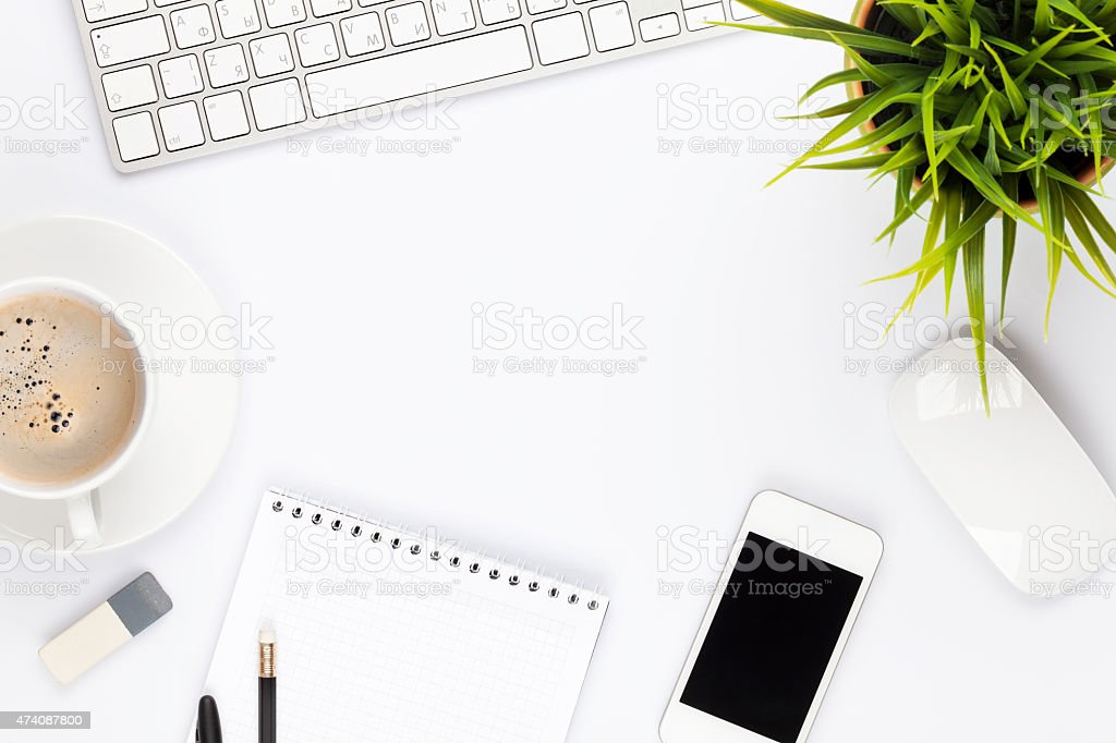 Office desk table with computer, supplies, flower and coffee cup stock photo