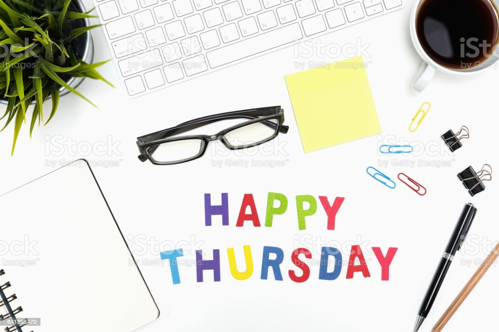 Office desk table with happy thursday word stock photo