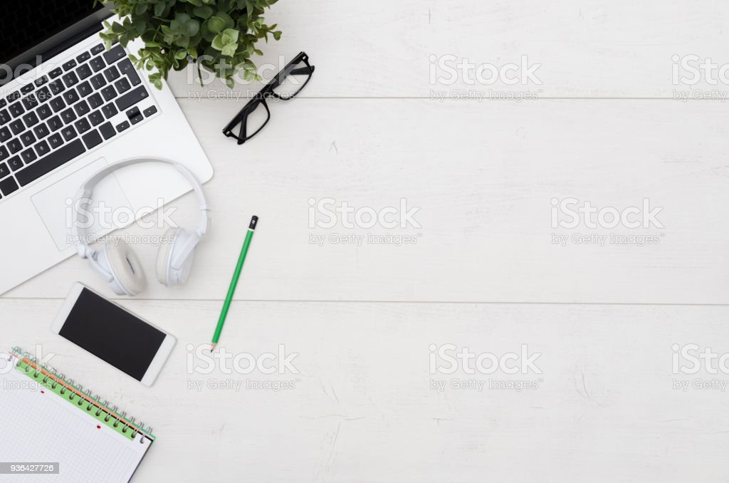 Office desk table with laptop, smartphone and supplies stock photo