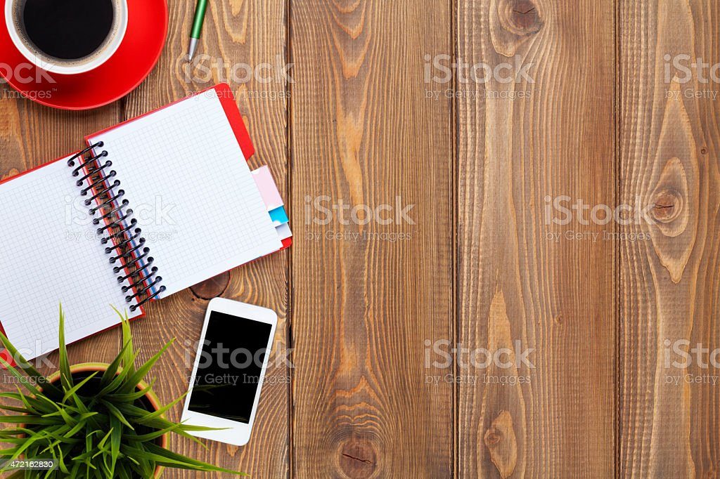 Office desk table with supplies, coffee cup and flower stock photo