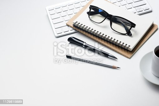 istock Office desk table with supplies. Flat lay Business workplace and objects. Top view. Copy space for text 1129815889
