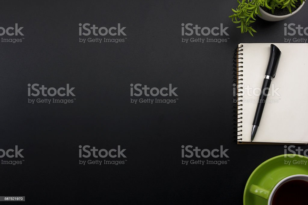 Office desk table with supplies. Top view. Copy space for stock photo