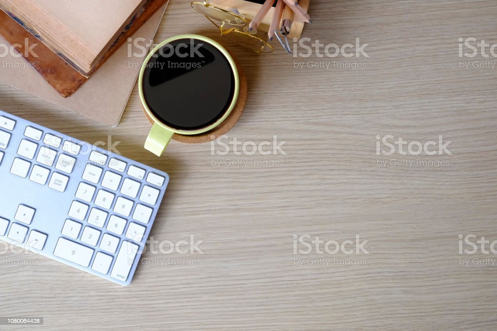 Astonishing Office Desk Top View Computer Coffee And Books On Wood Table Interior Design Ideas Clesiryabchikinfo