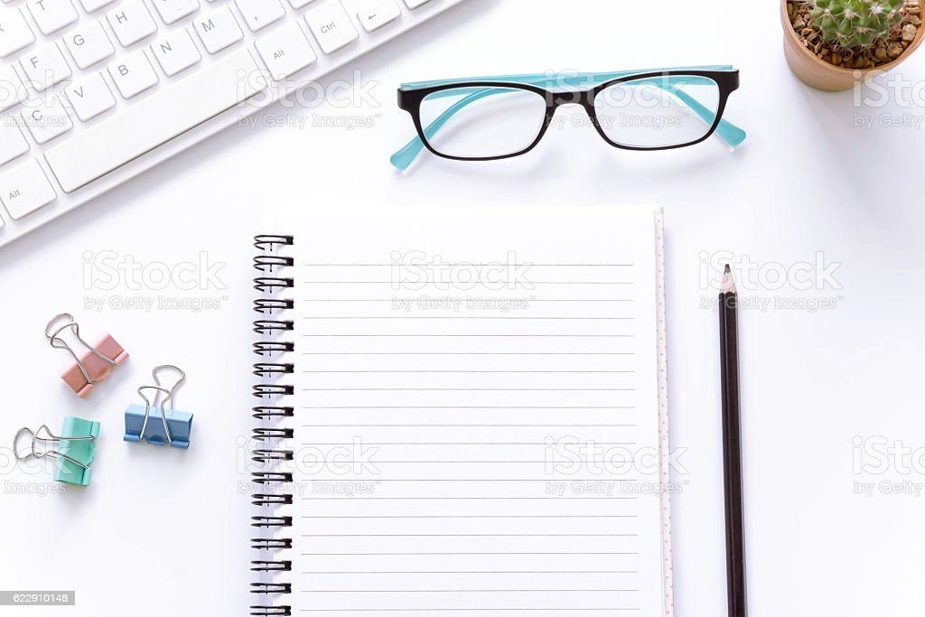 Office desk top view , laptop eyeglasses and book. stock photo