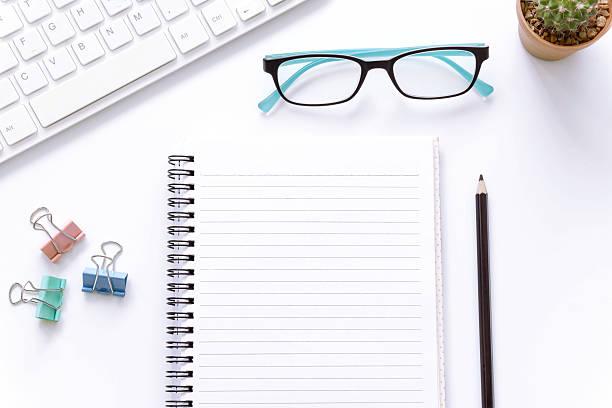 office desk top view , laptop eyeglasses and book. - organizzatore elettronico foto e immagini stock