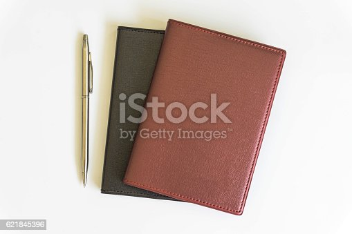 621843818 istock photo Office desk top view with book 621845396