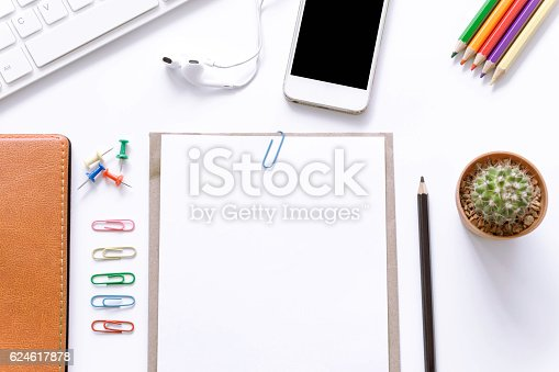 621843818istockphoto Office desk top view with smartphones, laptop and book 624617878