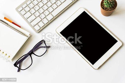621843818istockphoto Office desk top view with smartphones 626144658