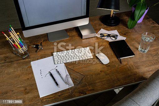 509867718istockphoto Office desk with accessories 1178913865