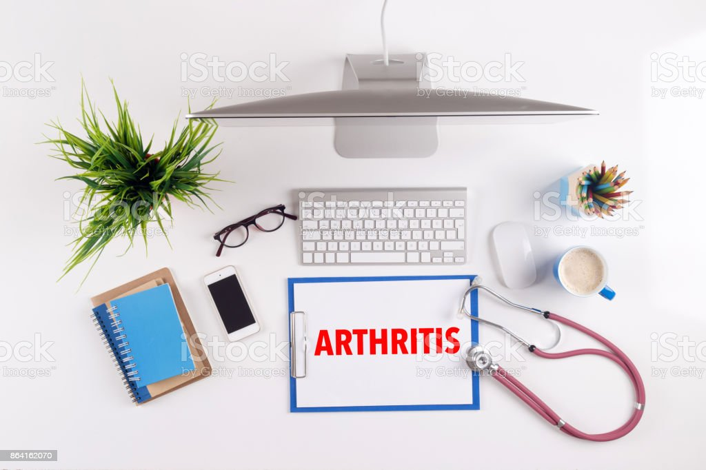 Office desk with ARTHRITIS paperwork and other objects around, top view royalty-free stock photo