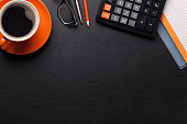 istock Office desk with coffee and supplies 855749974