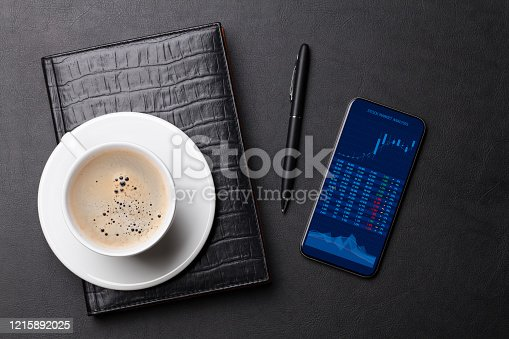 istock Office desk with coffee, notepad, phone and pen 1215892025