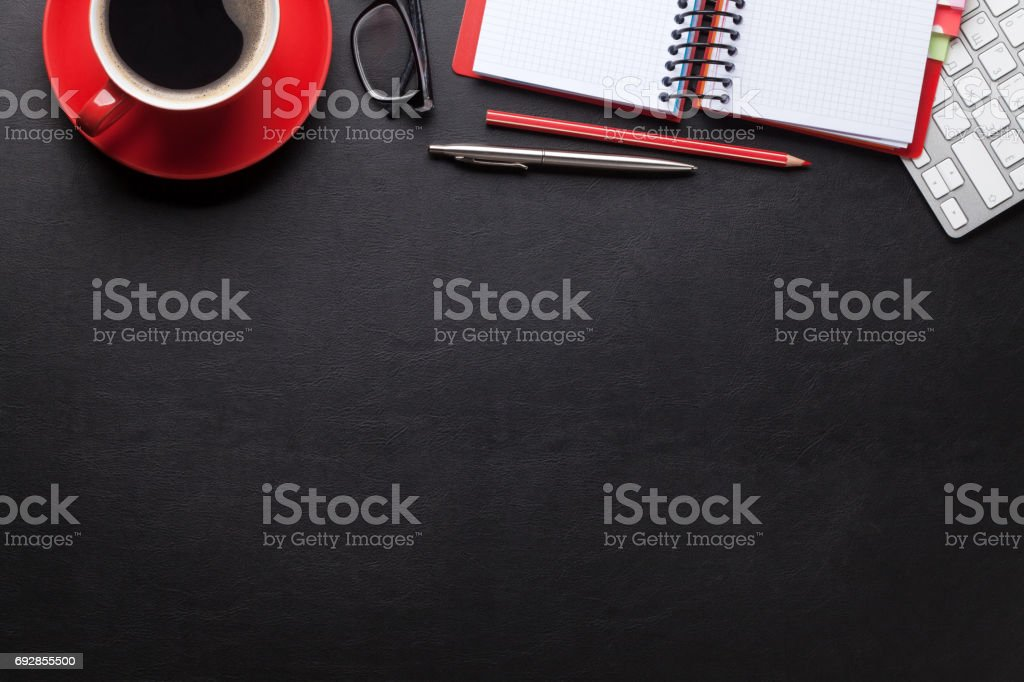 Office desk with computer and supplies stock photo