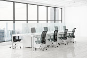 Office Desk With Glass Partition Dividing Them