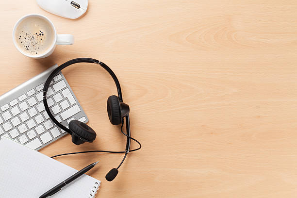 Office desk with headset and pc stock photo