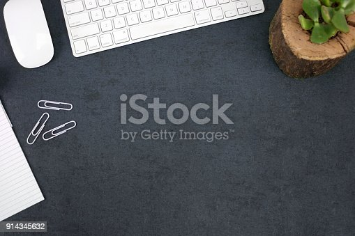 istock Office Desk with Keyboard, Succulent Plant, Paper and Computer Mouse 914345632