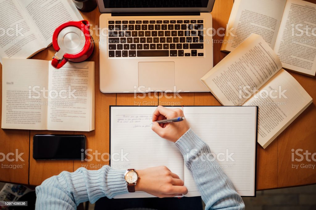 Office desk with laptop and books, top view - Стоковые фото Бизнес роялти-фри