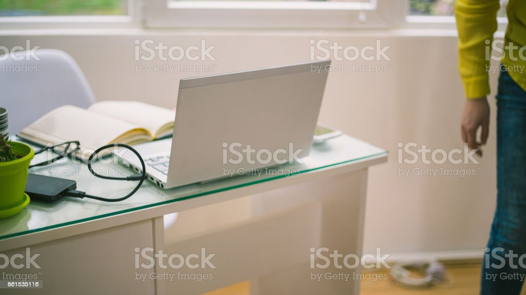 Office Desk With Laptop Smart Phone And Business Office Background