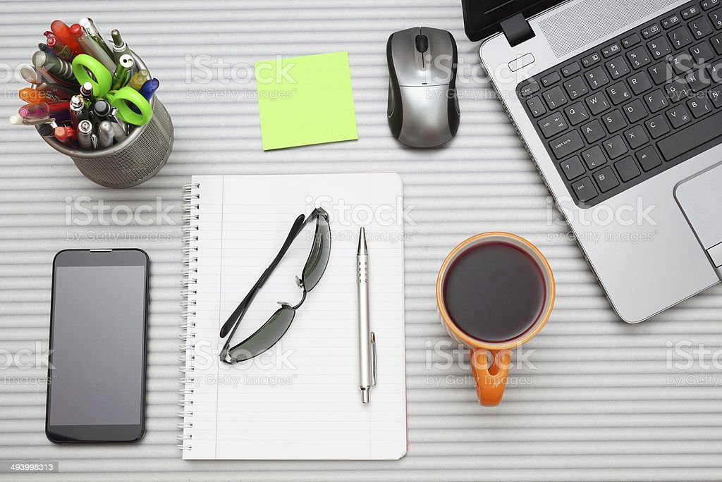 office desk with laptop with business accessories and cup of tea stock photo