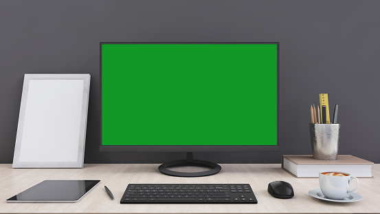 Office Desk With Large Pc Computer Screen With Green Background Template Stock Photo Download