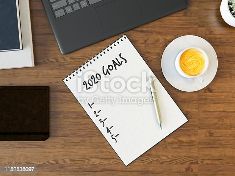 istock Office Desk with New Year Goals List 1182838097