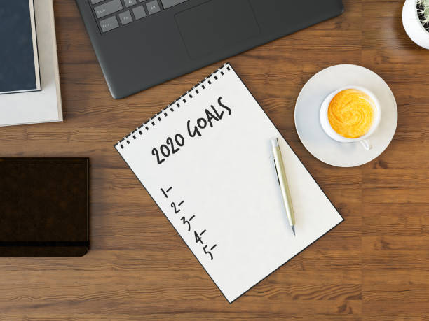Office Desk with New Year Goals List stock photo