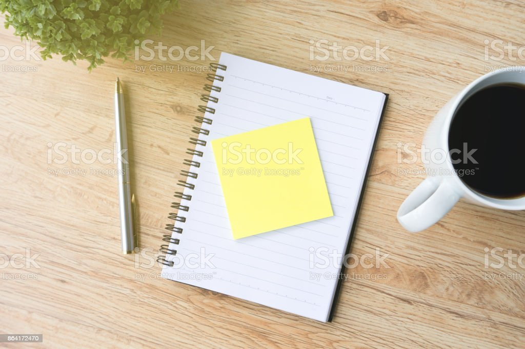 Office Desk with Note Pad, Coffee, Pen and Plant royalty-free stock photo