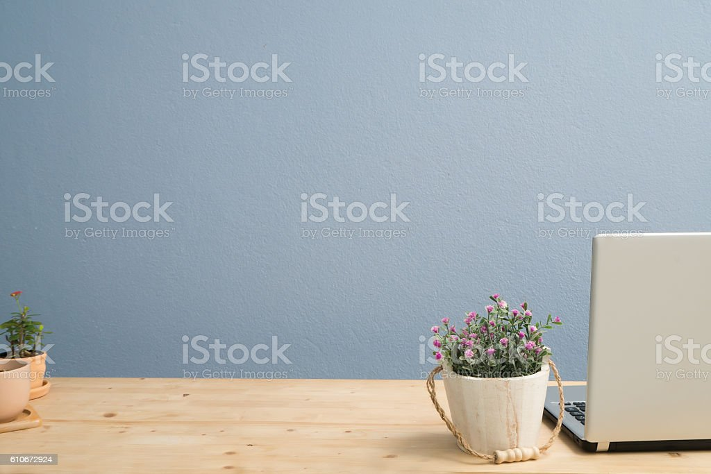 Office Desk with pink rose flowerpot . stock photo
