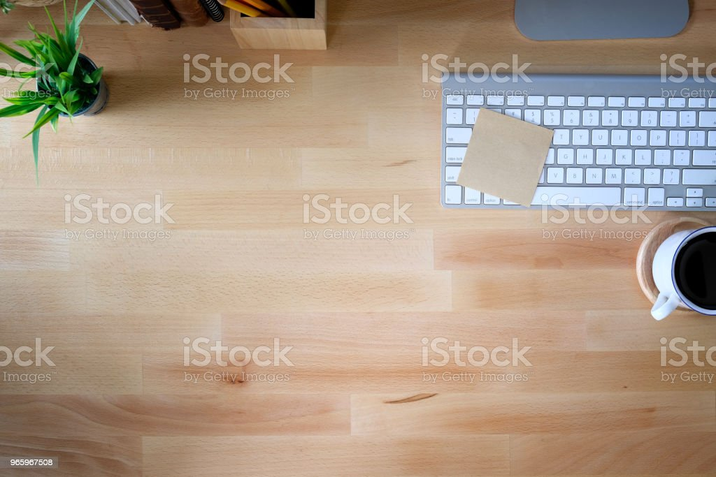 Office desk wooden table with keyboard computer,  cup of coffee and flower. Top view with copy space - Royalty-free Above Stock Photo